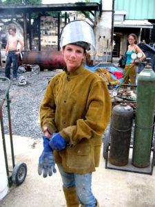Maressa pouring iron at an iron pour